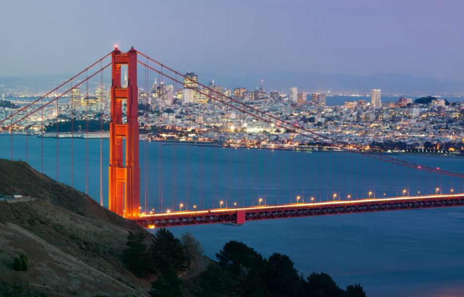 Image of Golden Gate Bridge with San Francisco skyline in the background.
